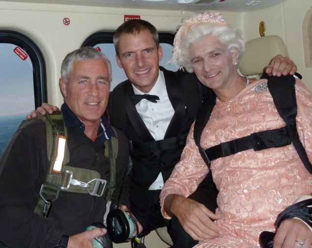 """Gary Connery, the skydiving """"Queen"""" prepares for his dramatic arrival at the Olympics opening ceremony on Friday night pictured in the helicopter en route to the stadium. Collect Picture by Connery/Waldegrave See story Padraic Flanagan"""